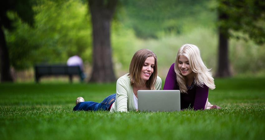 Student with Laptop in the Park
